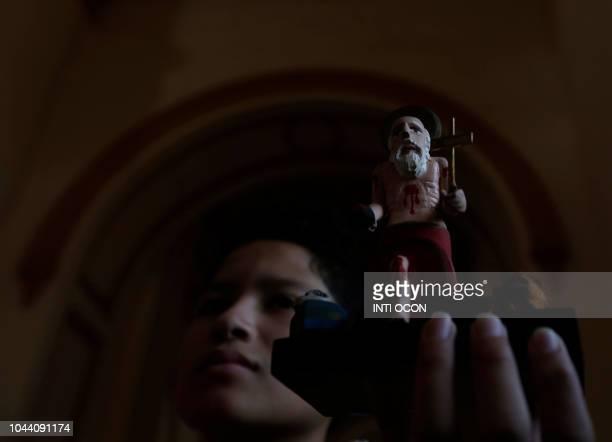 A kid carries an image of San Jeronimo in San Jeronimo Church during celebrations of San Jeronimo the patron saint of Masaya in Masaya some 30 km...