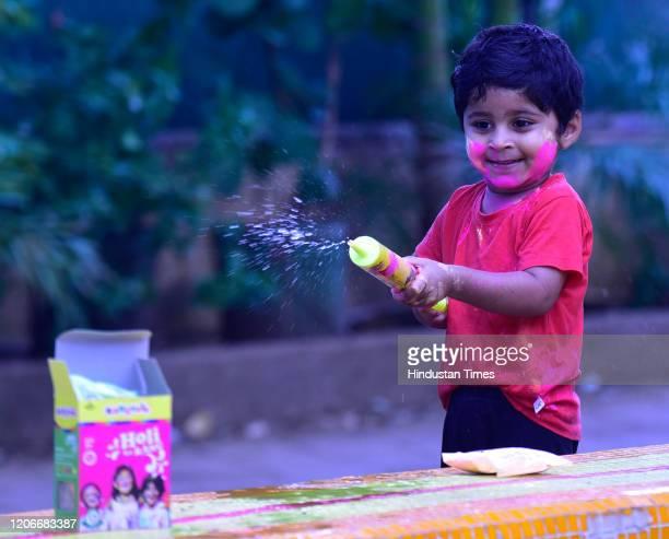 A kid celebrates festival of colors on occasion of Holi at Worli Koliwada on March 10 2020 in Mumbai India
