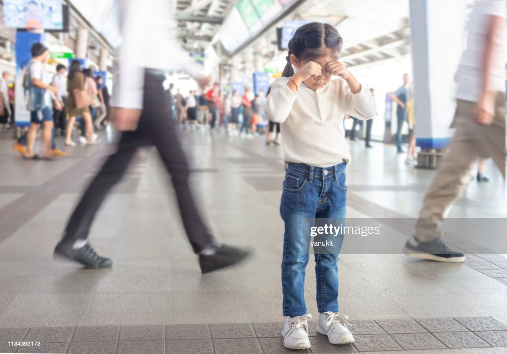 kid crying to lost parent on sky train station. : Stock Photo
