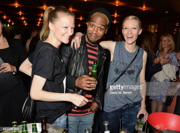 Kid Cudi poses with BLAG founders Sally Edwards and Sarah Edwards at the official launch of the BLAG clothing label at The Club at Cafe Royal on July...