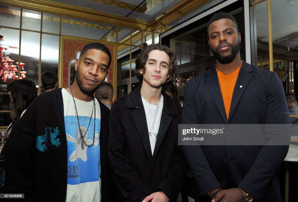 Kid Cudi, Timothee Chalamet, and Winston Duke attend GQ and Oliver Peoples Celebrate Timothee Chalamet March Cover Dinner at Nomad Los Angeles on February 20, 2018 in Los Angeles, California.