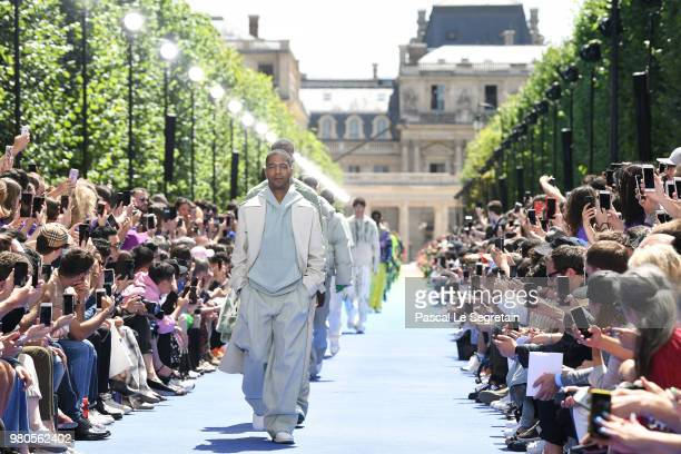 Kid Cudi walks the runway during the Louis Vuitton Menswear Spring/Summer 2019 show as part of Paris Fashion Week on June 21 2018 in Paris France