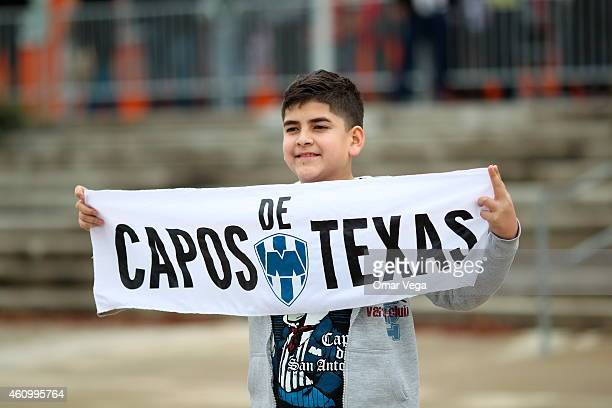 A kid displayes a flag before a friendly match between America and Monterrey at BBVA Compass Stadium on January 03 2015 in Houston United States