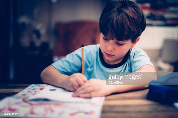 kid doing homework - pencil case stock photos and pictures