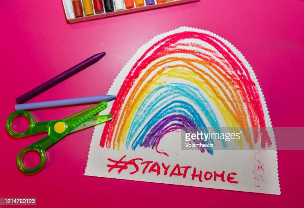 kid drawing a rainbow with colors at home - rainbow stock pictures, royalty-free photos & images