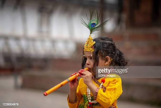 A kid dressed as Lord Krishna during the festival at Hanuman Dhoka Sadak near Kathmandu Durbar Square Krishna Janmashtami is an annual Hindu festival...