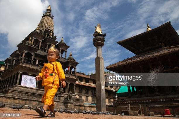A kid dressed as Lord Krishna during the festival at Krishna Mandir Krishna Janmashtami is an annual Hindu festival that celebrates the birth of...