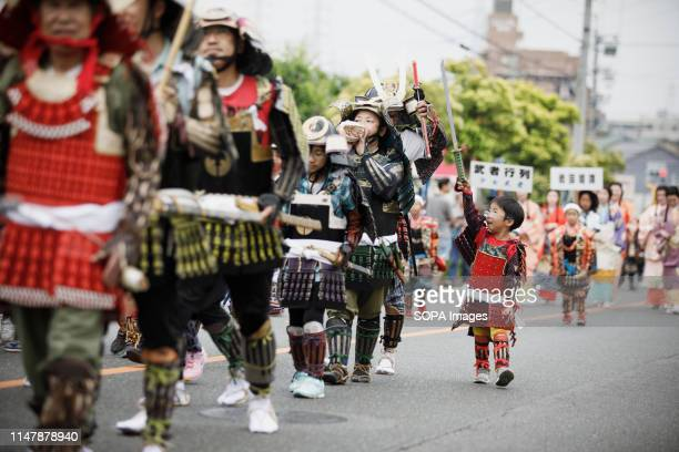 A kid dressed in samurai warrior armour holds a sword during the Okehazama Historical Battlefield Festival in Aichi Toyoake In 1560 Oda Nobunaga and...
