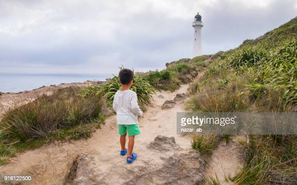 Kid during a walk at Castlepoint Lighthouse.