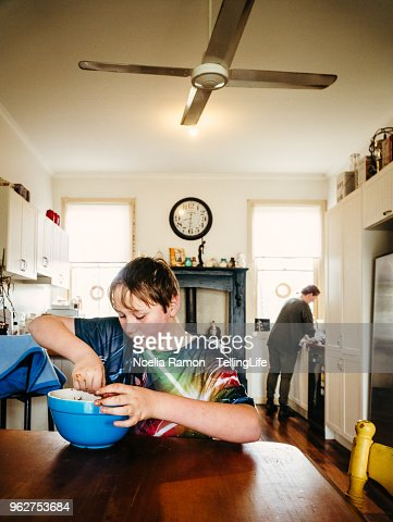 A kid eating chocolate in a kitchen in rural Victoria, Australia