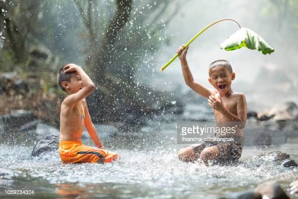 kid enjoy playing splashing water