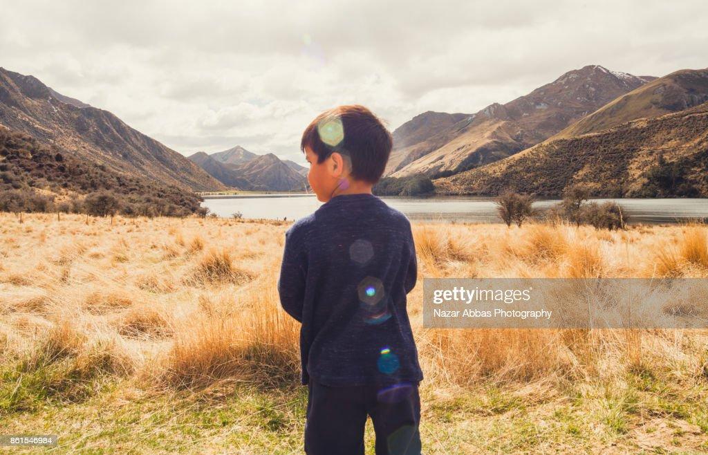 Kid Enjoying a view at Lake Moke, Queenstown, South Island, New Zealand. : Stock Photo