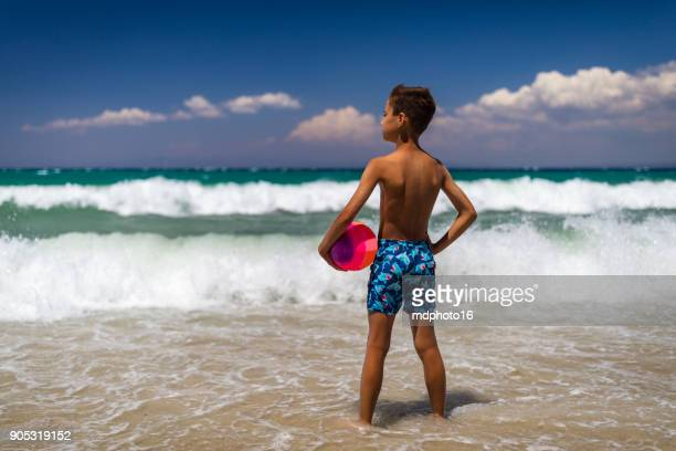 Kid enjoying sunny day at a beach