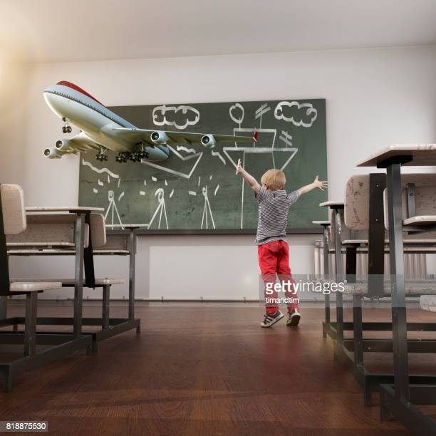 Kid excited with his realistic drawing in a blackboard