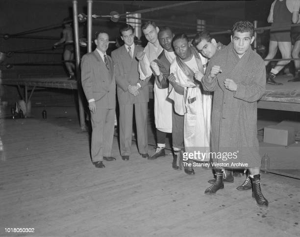 Kid Gavilan and a group of fellow boxers pose for a portrait in Stillman's Gym circa 1955 in New York City New York