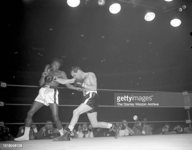 Kid Gavilan and Bobo Olson exchange punches during their bout in Chicago Stadium Chicago Illinois April 2 1954 Bobo Olson goes on to be declared the...