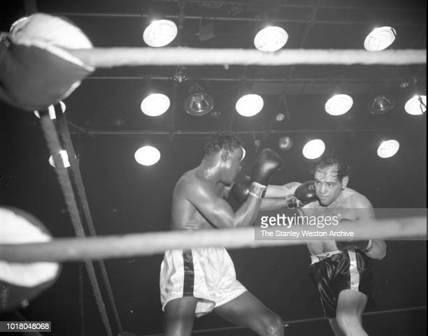 Kid Gavilan land a left hook punch to Bobo Olson in Chicago Stadium Chicago Illinois April 2 1954 Bobo Olson goes on to be declared the World Middle...
