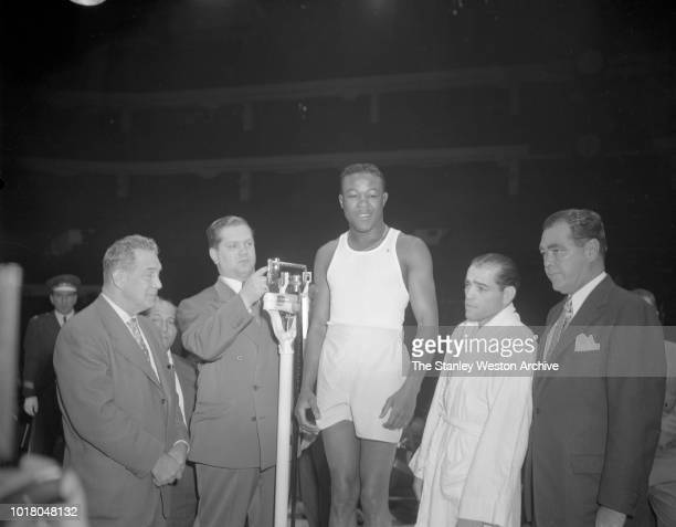 Kid Gavilan weighs in before his bout against Bobo Olson in Chicago Stadium Chicago Illinois April 2 1954 Bobo Olson goes on to be declared the World...