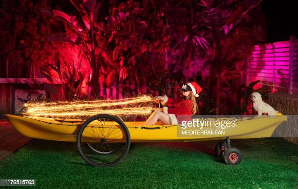 kid girl as santa with vr glasses over a kayak - rein stock pictures, royalty-free photos & images