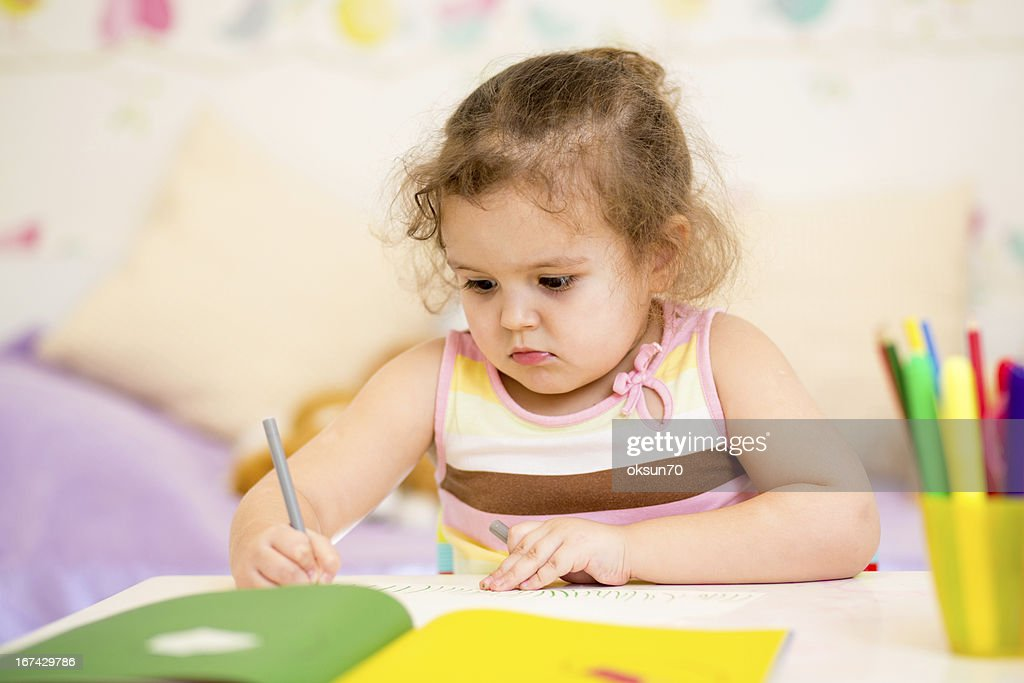 kid girl drawing with felt-tip pen : Stock Photo