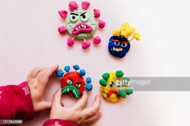 kid handmade coronavirus ugly monsters made with plasticine - clay stock pictures, royalty-free photos & images
