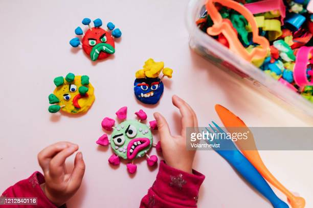 kid handmade coronavirus ugly monsters made with plasticine - medical condition stock pictures, royalty-free photos & images