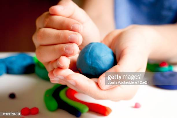 kid hands playing and creating from modeling clay - earth day stock pictures, royalty-free photos & images