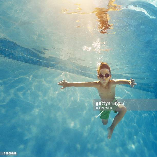 kid having a good time in the pool
