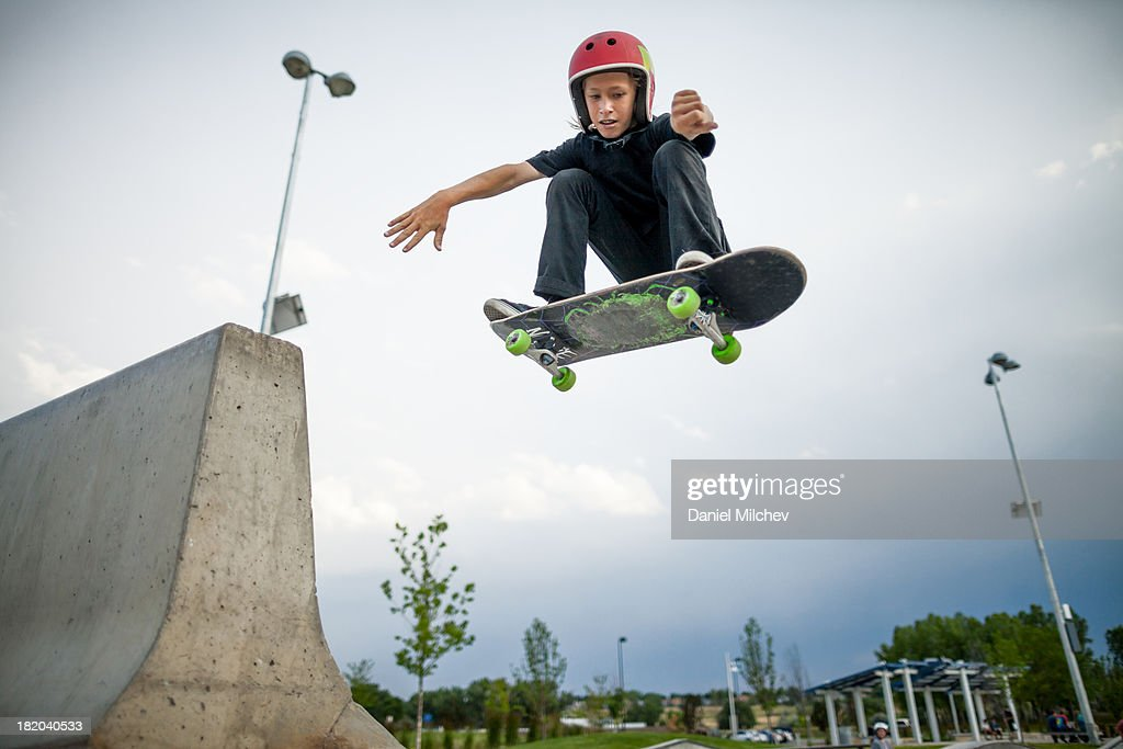 Kid, having fun skateboardin and jumping. : Stock Photo