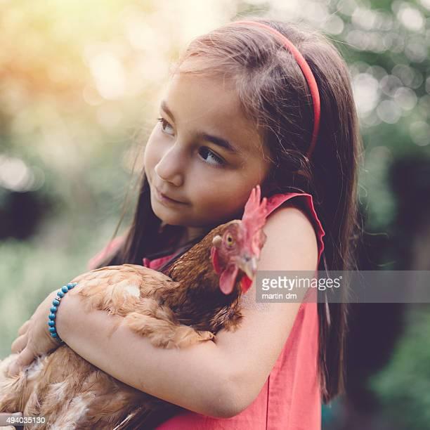 Kid holding a hen