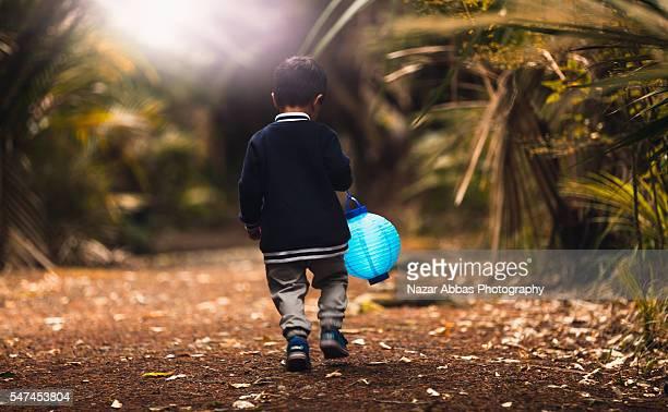 Kid Holding Lamp.