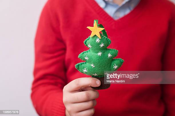 Kid holding stuffed christmas ornament