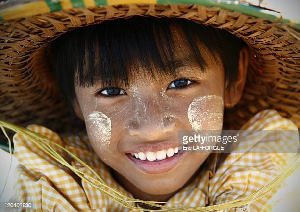 Kid in Myanmar on December 31, 2005 - On the face: some Thanaka paste. Most of the girls, j-kids and even men in Myanmar use this paste made from...