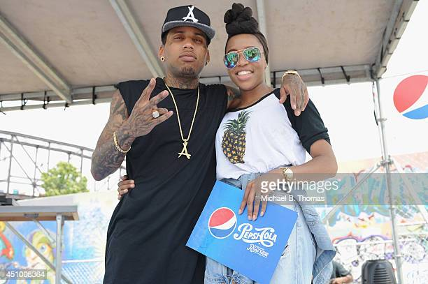 Kid Ink meets with a lucky fan who received a backstage pass after Kid Ink performs at Pepsi Summer Solstice concerts on Vevo June 21 2014 in St...