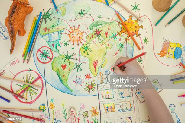 kid is drawing planet earth and covid-9 - dusan stankovic stock pictures, royalty-free photos & images