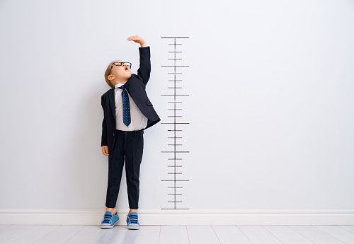 Kid is measuring the growth 1151779376