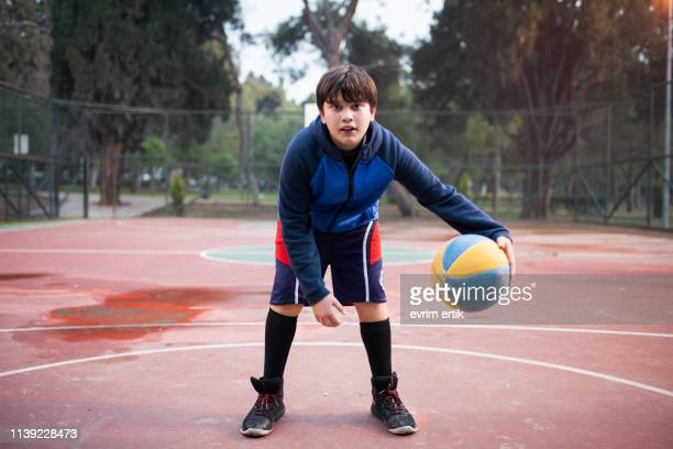 kid is playing basketball - sporting term stock pictures, royalty-free photos & images