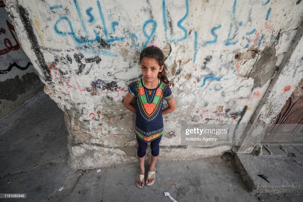 A kid is seen at Al-Shati Palestinian refugee camp in Gaza