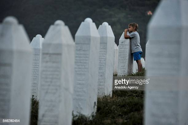 A kid is seen at Potocari Memorial Center after funeral ceremony of 127 people who died in the Srebrenica Massacre during in Potocari Bosnia and...