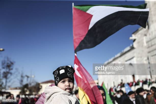A kid is seen during a protest against the US President Donald Trump's recognition of Jerusalem as Israel's capital at Fatih Mosque in Istanbul...