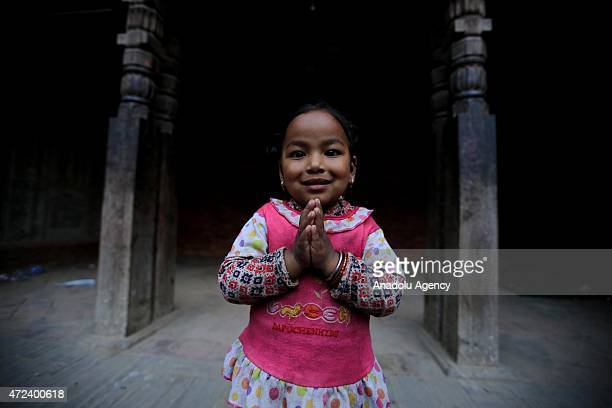 Kid is seen in front of a building in the Bhaktapur city, 20km from the capital Kathmandu, Nepal on May 06, 2015 after the devastating 7.8-magnitude...