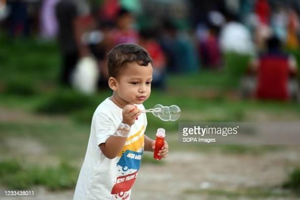 Kid is seen playing at Hatirjheel park in Dhaka.