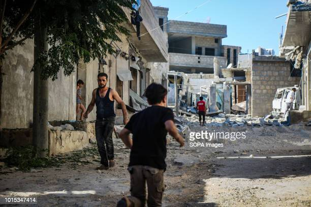 A kid is seen running through a street lined with damaged buildings 9 Anti Government militants are dead and more than 45 injured as a result of...