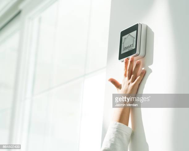 Kid is trying to reach smart home touch screen
