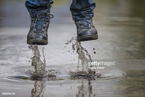 kid jumping in water - wet jeans stock photos and pictures