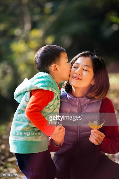Kid kissing mother