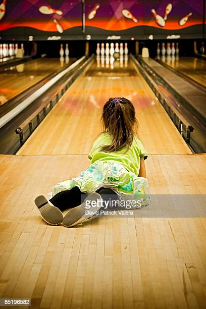 Kid Laying Down In A Bowling Alley
