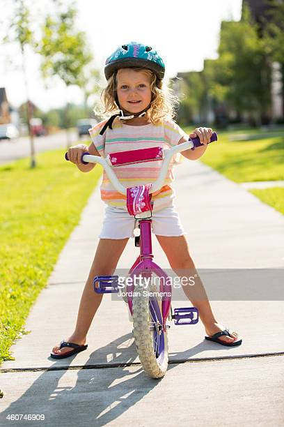 Kid learning to ride a bike.
