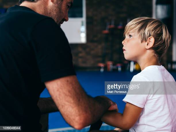 Kid learns from boxing mentor