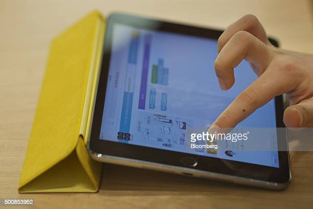 A kid learns how to build a video game using code on an Apple Inc iPad Mini during the Hour of Code workshop at an Apple store in New York US on...